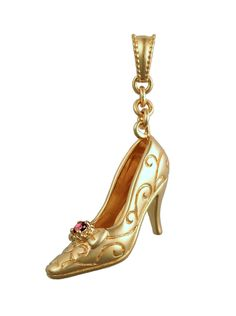 """Inspired by the spectacular high heels featured in the Brooklyn Museum exhibition and book, Killer Heels:  The Art of the High-Heeled Shoe, jewelry designer Rémy Rotenier designed six miniature shoes, each with its own unique character.  Shown: """"Paris"""" in rose gold-plated sterling silver studded with a garnet gemstone.  Goldex Fine Jewelry ~ (323) 726-7181."""