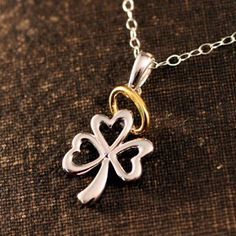 Our Halo Shamrock Necklace is simply heavenly. It's a whimsical celebration of the little angel in every Irish girl. This traditional Irish shamrock with a halo in bright polished sterling silver with yellow gold accents creates a wonderful this eye-catching design worthy enough to be called Irish.  A wonderful gift for the little Irish angel God blessed you with.