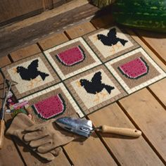 "Quaint crow and watermelon motifs turn this handy rug into a cute accent to welcome guests to your home. The design is stitched using two strands of worsted weight yarn and 5 mesh plastic canvas. Number of Designs: 1 mat Approximate Design Size: 25""w x 16-1/2""h"