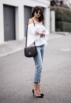 Talisa Sutton looks elegant and stylish in this off the shoulder blouse, paired with cropped denim jeans and a pair of black heels. Throw on some vintage style shades to capture Talisa's cool girl vibes. Top: THPSHOP, Jeans: The Fifth Label Denim Bag: Coach.