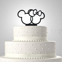 Mickey Mouse and Minnie Wedding Cake Topper is a tender and unique way of expressing your love on your special day. This is a one time use item as I