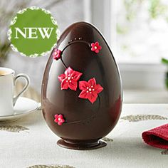 Dark Chocolate  Geranium Easter Egg | Beautifully hand-decorated with Royal iced and sugar paste geranium flowers, this Swiss dark chocolate egg is flavoured with fragrant geranium.