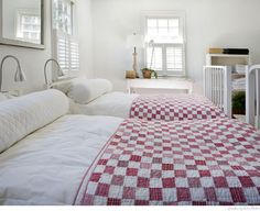 Red and white postage stamp quilts.