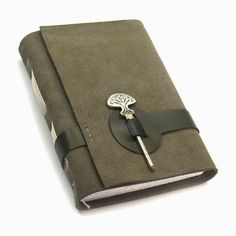 Handmade leather notebook by MedievalJourney on Etsy. Could use a pen for the closure instead of a key.