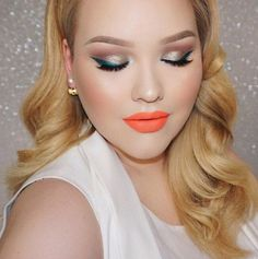 We're over here in complete awe of @nikkitutorials and this tantalizing #makeupoftheday ❤❤ With thanksgiving right around the corner, what do you gals think of these blue wings and orange lips? #love #BellettoStudio #motd