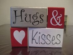 Vinyl on painted wood blocks -- Hugs & Kisses