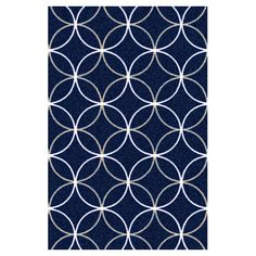 Add a pop of pattern to your living room or den with this hand-tufted rug, showcasing a trellis motif.   Product: Rug