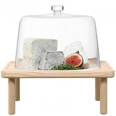 Stilt cheese dome & ash stand - A stackable serving piece for presenting cheeses, cakes, pastries or desserts on any occasion. A mouthblown glass dome fits on a wooden stand with turned legs made from natural ash.