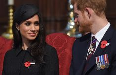 Britain's Prince Harry (R) and his US fiancee Meghan Markle attend a service of c