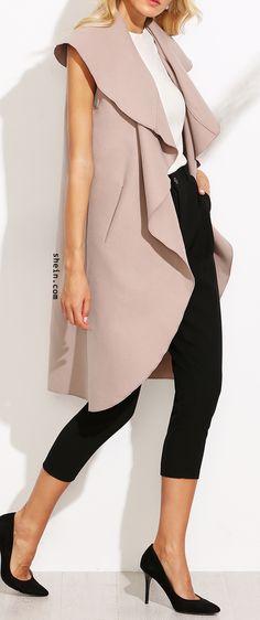 Pink oversized waterfall sleeveless coat.