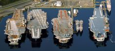 """Four retired carriers from left to right: USS Independence CV-62, USS Kitty Hawk CV-63, USS Constellation CV-64 & USS Ranger CV-61. Indy and Connie look in bad shape. They are in the process of being prepped for disposal. Ranger is still on donation hold and, hopefully, will be going to Portland as a museum. Kitty Hawk is listed at the Naval Vessels Register as """"out of commission, in reserve."""""""