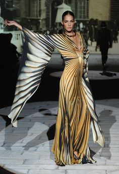 Roberto Cavalli - super dramatic gown... no idea where to wear it, but I love this image.
