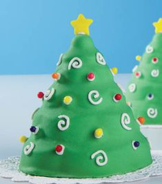 Christmas tree mini cakes from @Wilton Cake Decorating Cake Decorating are perfect for a holiday party dessert!