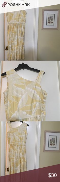 Vintage yellow dress 80's does 40's size M/L Awesome vintage yellow buttercream dress. My best guess is 1980's imitating another era. It's 100% cotton and has a great button detail down the side of the bodice. There's a hidden zipper down the side of the skirt. It would best fit a size 8-10. Tag says 10 Dresses Midi