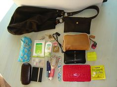 After a return trip my purse is always loaded & generally has a camera in it! Can't do without one item!!  **Lucky Brand brown suede purse with attached coin purse for my passport & visa, Vera Bradley Sunglass case, hand towelettes, palmolive hand cre   Click on the image for more info.  http://www.woodenpurses.com