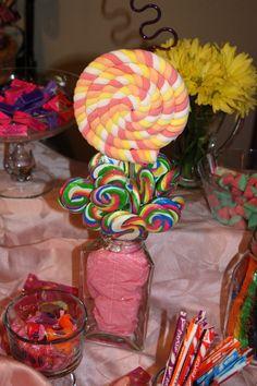 Rainbow lollipops for sweet shop birthday.