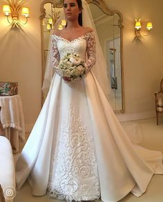 Discount 2018 Elegant White A Line Wedding Dresses Off Shoulder Long Sleeve Lace Appliques Sexy Back Button Bridal Dresses Charming Wedding Gowns Ivory Wedding Dresses Long Sleeve Wedding Dress From … Making A Wedding Dress, Wedding Dress Train, Applique Wedding Dress, Princess Wedding Dresses, Wedding Dress Sleeves, Modest Wedding Dresses, Cheap Wedding Dress, Lace Dresses, Bridal Dresses