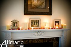 Reception decor - wedding fireplace mantle with candles, rose petals, and pictures