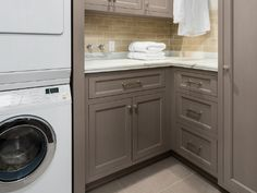 Home decor trends for 2017 include more efficient laundry room storage. Like the classic look of these shaker style cabinets