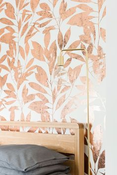 Rye features bold oversized leaves, complementing the bestselling metallic Columbia Road design of large eucalyptus stems. Inspired by the Barbican Conservatory in London Rye offers an elegant and rich composition in copper, using CUSTHOM's hand foiled finish. The repeating pattern fills the space with meandering branches, the metallic finish of the leaves catching the light and casting it back into the room. Printed on to durable non-woven FSC certified wallpaper.  Colour – Copper on white…