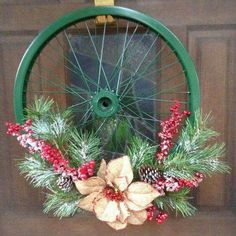 Everyone loves the thought of an elegant holiday, but without a background in Christmas decorating, it's hard to know exactly how to go about making your own Holiday Crafts, Christmas Crafts, Christmas Decorations, Bicycle Wheel Decor, Bike Wheel, Bicycle Rims, Wreath Crafts, Flower Crafts, Bicycle Crafts