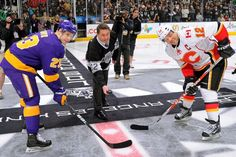 LOS ANGELES, CA - MARCH 9: Former King Kelly Hrudey drops the ceremonial first puck with Dustin Brown #23 of the Los Angeles Kings and Jarome Iginla #12 of the Calgary Flames at Staples Center on March 9, 2013 in Los Angeles, California. (Photo by Noah Graham/NHLI via Getty Images)