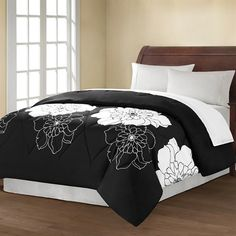 Give a fresh, modern look to your bedroom with the Avery Floral comforter. The comforter features a beautiful black and white floral printed on microfiber and reverses to solid black. This black and white floral comforter is bold and will make a statement in any room.