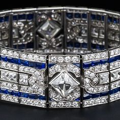 Art Deco diamond and sapphire bracelet. 2 French cut diamonds, 3.20 tcw, VS1, VS2/1-K color. 40 French cut diamonds, 8.00 tcw, VS/F-G; 320 transitional round brilliants 6.50 tcw VS/F-G; 136 calibre cut sapphires 7.0 tcw. Platinum. Delicious. I need a cold shower now.