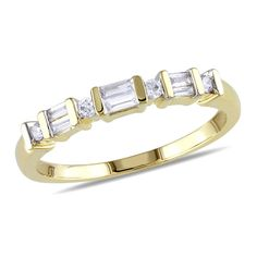 Surprise and delight her with the sleek look of this diamond anniversary band. Crafted in warm 10K gold, this slender design features alternating channel-set round and pairs of baguette-cut diamonds. Sparkling with 1/5 ct. t.w. of diamonds and a bright polished shine, this anniversary band is a romantic reflection of your love.