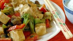 This is a quick and easy way to make a well balanced, delicious meal.  Broccoli, red bell pepper and mushrooms are sauteed with tofu in a savory peanut sauce.  Serve over your favorite rice.