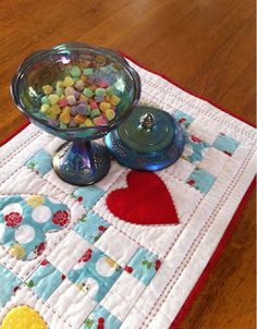 A Farm Wife's Journal: Candy Hearts Table Runner Tutorial The table runner is made with an uneven nine patch blocks and heart appliqué blocks. This was quick and easy to put together.