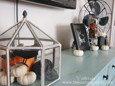 Scatter a repeated element throughout a room for a cohesive feel, as these white pumpkins are here