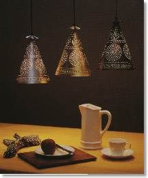 Cool punched tin lamps - always looking for things I can make without a workshop.  Christmas presents anyone?