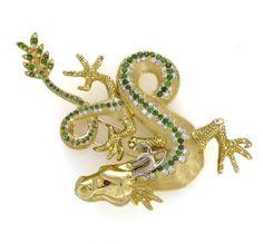 A demantoid garnet and diamond dragon brooch