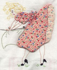 Embroidered and appliqued tea towel with skirt potholder. Under that skirt she has a bare bottom!