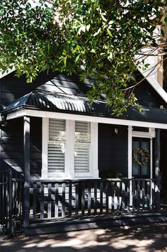 """The home's exterior facade is painted in Dulux 'Domino'. """"I really wanted the house to be dark, which is similar to the little summer cottages you see on the lakes in Sweden,"""" says Libby. Design Exterior, Exterior Paint Colors, Exterior House Colors, Paint Colors For Home, Paint Colours, Exterior Doors, Exterior Wall Cladding, Exterior Color Schemes, Exterior Stairs"""