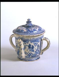 """1630-1635 English Posset pot at the Victoria and Albert Museum, London - From the curators' comments: """"A disproportionate number of posset pots have survived, as they were often used only on special occasions and given as gifts....At the end of the 17th century delftware, Staffordshire slipware and glass posset pots became large and highly decorated, indicating a high point in their ceremonial function which, by the middle of the 18th century, seems to have fallen into disuse."""""""