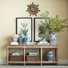 Console table could be useful in several spots: behind sofa in existing location, beside media cabinet or if furniture were rearranged. An alternative would move two armchairs or sofa to face fireplace and put slim console table bedind.