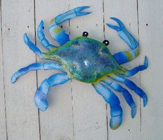 Beachy decor.  Blue crab.  Twist:   Buy cheap ones at deal$ or oriental trading and spray paint a solid color.