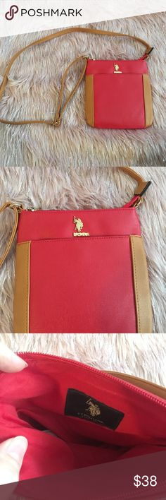 U.S. Polo Assn. Red and Cognac Crossbody Bag U.S. Polo Assn. Red and Cognac Crossbody Bag Red and Cognac Crossbody Purse.   Condition: Great, no stains inside.  This Purse is in great condition. There is a front pocket that buttons. Main pocket has a zipper with gold accents. The first two photos are stock photos of the purse. Measurements: 8 x 8 1/2 ✨NO TRADES ✨ ✨YES, I do consider reasonable offers✨ Search: Mini Crossbody Bag U.S. Polo Assn. Bags Crossbody Bags