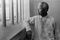 Nelson Mandela in his cell on Robben Island (Revisit), 1994. Gelatin Silver Print © Jürgen Schadeberg, Courtesy of Peter Fetterman Gallery