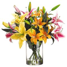 Faux lily arrangement in a glass vase. Product: Faux floral arrangementConstruction Material: Silk and glass