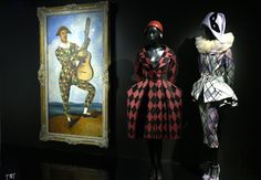 Designs by Gianfranco Ferré and John Galliano in the Dior exhibition at Les Arts Décoratifs.