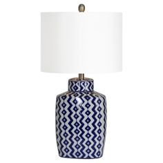 Classic blue and white porcelain lamp with modern geometric design, satin nickel accents and white drum shade finish this beautiful lamp. - Ceramic - Silk - Off White - - A - 1 - 100 - Ren-Wil - White Table Lamp, Table Lamp Sets, Light Table, Lamp Shade Store, Thing 1, Ceramic Table Lamps, Drum Shade, One Light, White Porcelain