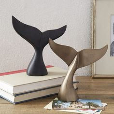 Make a splash. In either cast metal with a brass finish or soapstone, these Whale Tale Sculptures bring nautical style to tabletops and bookshelves.