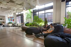 Quick Lefts Healthy and Productive Warehouse Offices.  Greenery, light control, and comfy seating for unconventional office space