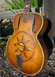 I think this is an Aragon Deluxe wooden resonator guitar