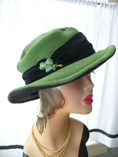 Leaf Green Brim Hat/Fedora with Velvet Band ~ One of a kind ~ Green with black on the underside of the brim. 2 1/2 inch brim hat with velvet band. The embellishment on this hat is a funky vintage pin. It was just perfect for this hat.  Dress it up or down. The 21/2 inch brim is flattering on any head and keeps the sun, snow and rain out of your eyes. Warm and cozy! These hats pull on like a toque and wrap your head in warmth. The brim hats have a flexible wire brim that allows ...