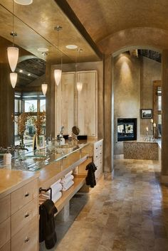 small & narrow for a master bath (for my taste) but I love the stone floors & room beyond