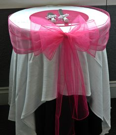 Fushia/Hot pink wedding cake table, coulda had a better table cloth though @Style Space & Stuff Blog Commons- Garrison we can use a different color